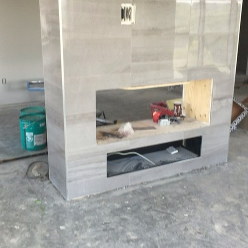 Complete_and_grouted_tile_reno_homes_fireplace_upgrade_classy_modern_gloss_throwbackthursday