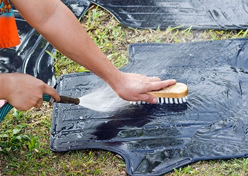 stock-photo-washing-car-rubber-mat-448538863