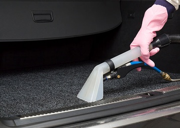 stock-photo-cars-luggage-carrier-chemical-cleaning-with-professionally-extraction-method-early-spring-cleaning-416000782