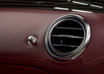 stock-photo-luxury-car-leather-dashboard-air-conditioning-system-and-airbag-panel-interior-detail-449391784
