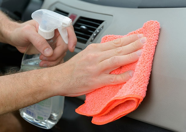 stock-photo-hand-with-cloth-cleaning-car-interior-496886254