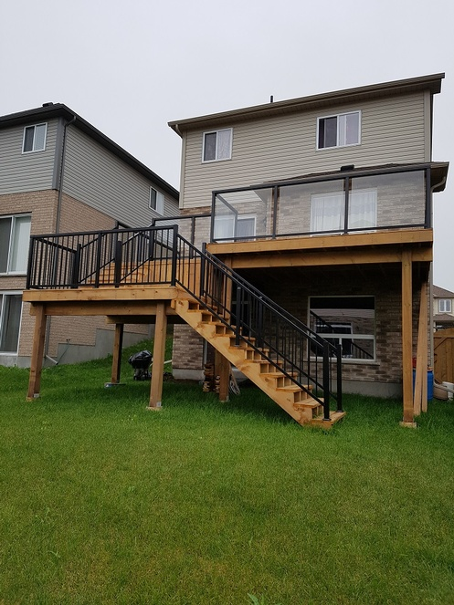 ProBuilt Railings with Glass on MicroPro Wood Deck