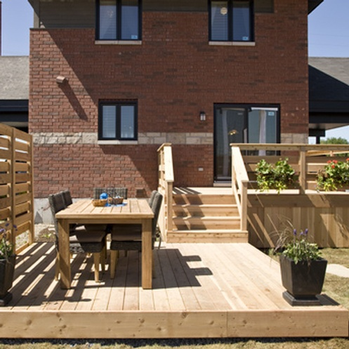 Split-level-deck-treated-wood-backyard